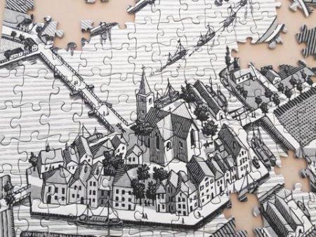 ジグソーパズルで出来た街並みのイラスト